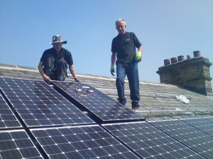 Installing solar panels on a roof in New Mills